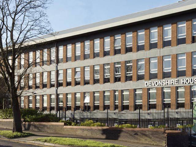 A photo of OCS' Head Office at Devonshire House Manor Way Borehamwood Herts WD6 1QQ